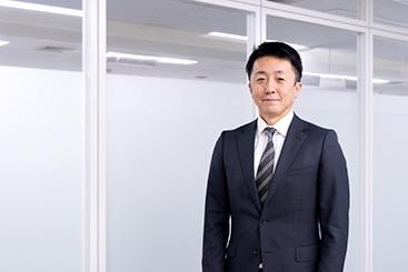 写真:プライムネット株式会社 代表取締役 眞柄 基